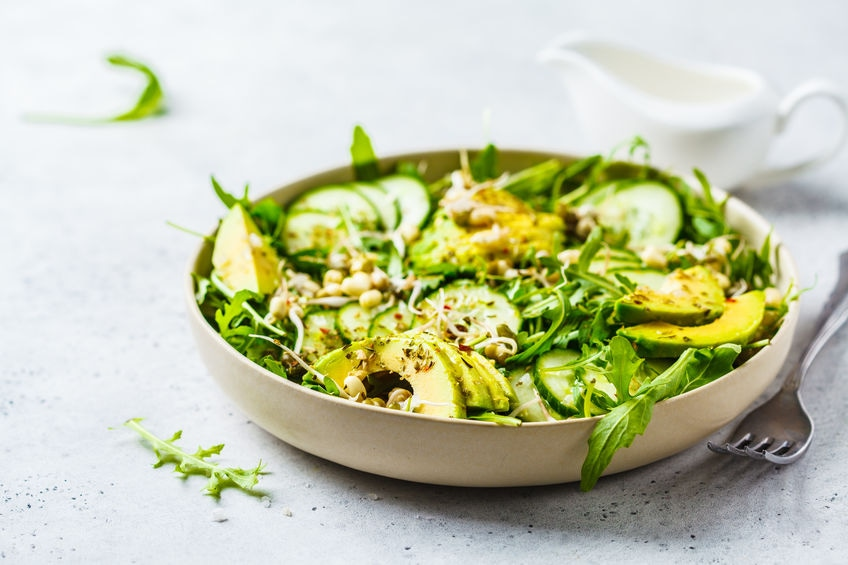 Healthy green salad with avocado, cucumber and arugula