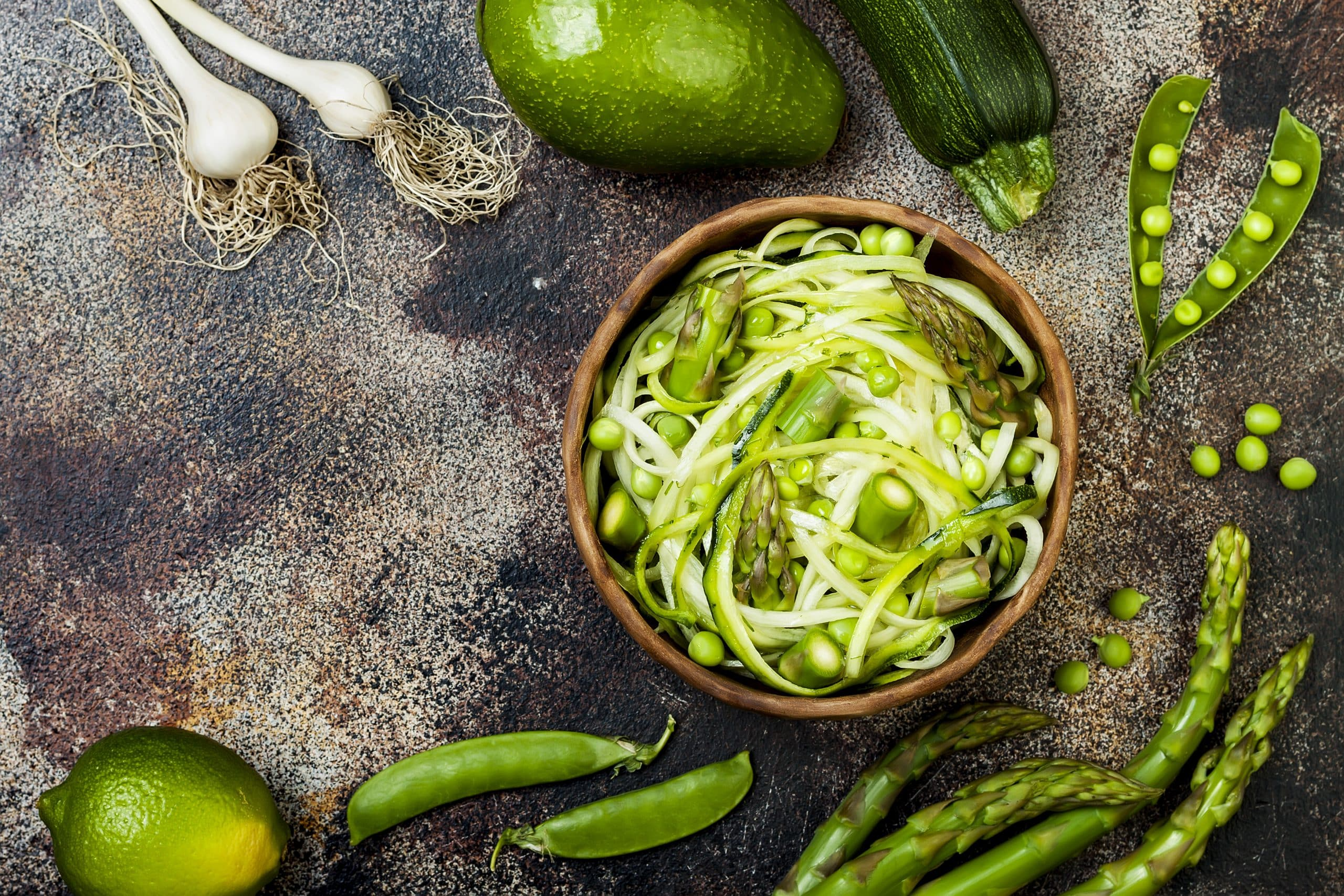Zucchini spaghetti or noodles (zoodles) bowl with green veggies. vegmeup, vegan, plant based, food box